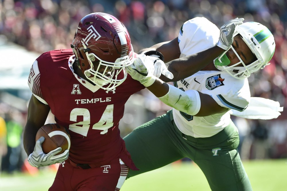 Oct 10, 2015; Philadelphia, PA, USA; Temple Owls running back David Hood (24) runs the ball in for a score while Tulane Green Wave safety Roderic Teamer (38) pulls his face mask at Lincoln Financial Field. The Temple Owls won 49-10. Mandatory Credit: Derik Hamilton-USA TODAY Sports